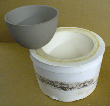 A slip cast bowl just removed from its plaster mold