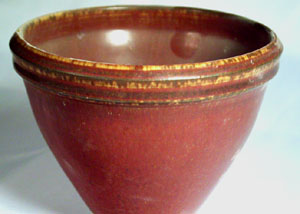 Red iron oxide in a high temperature reduction fired glaze