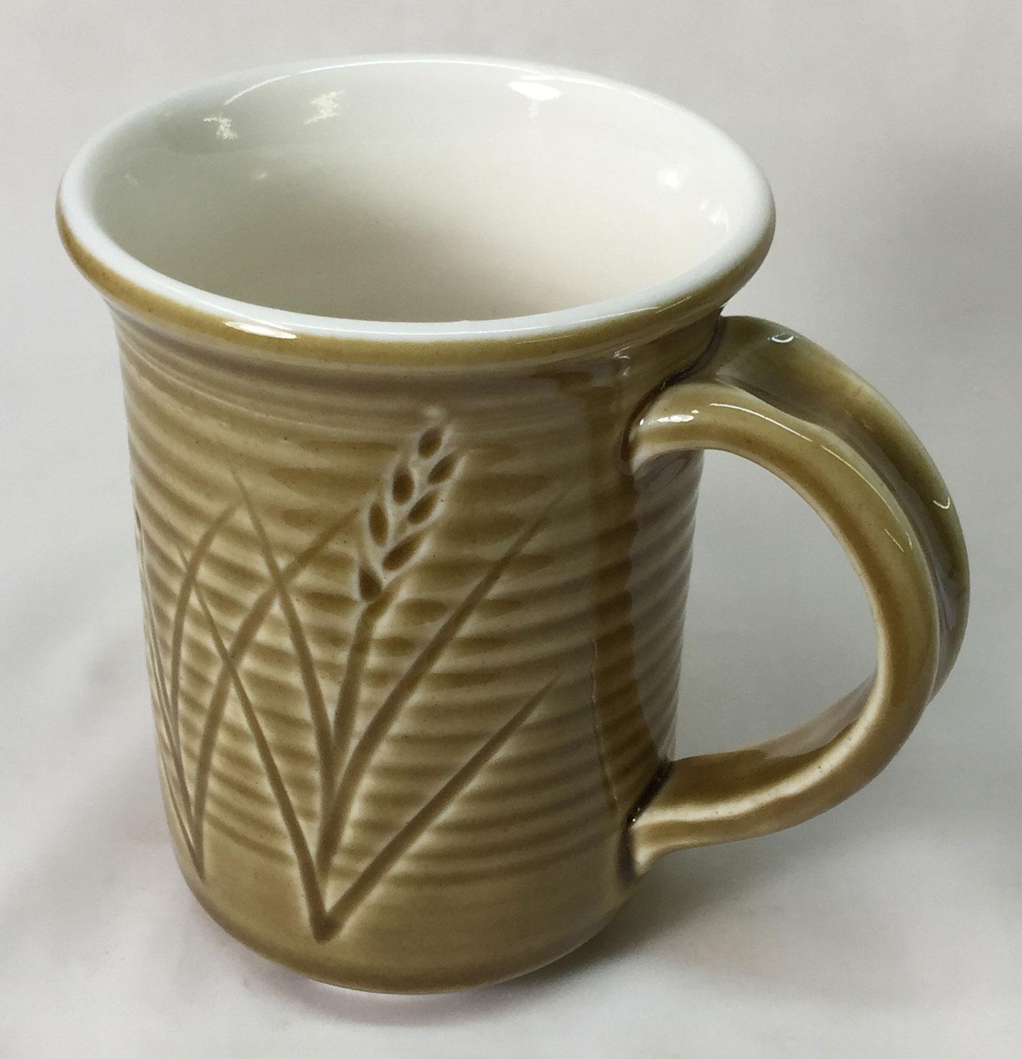 Alberta Slip base amber-clear glaze on the outside of a Polar Ice cone 6 mug