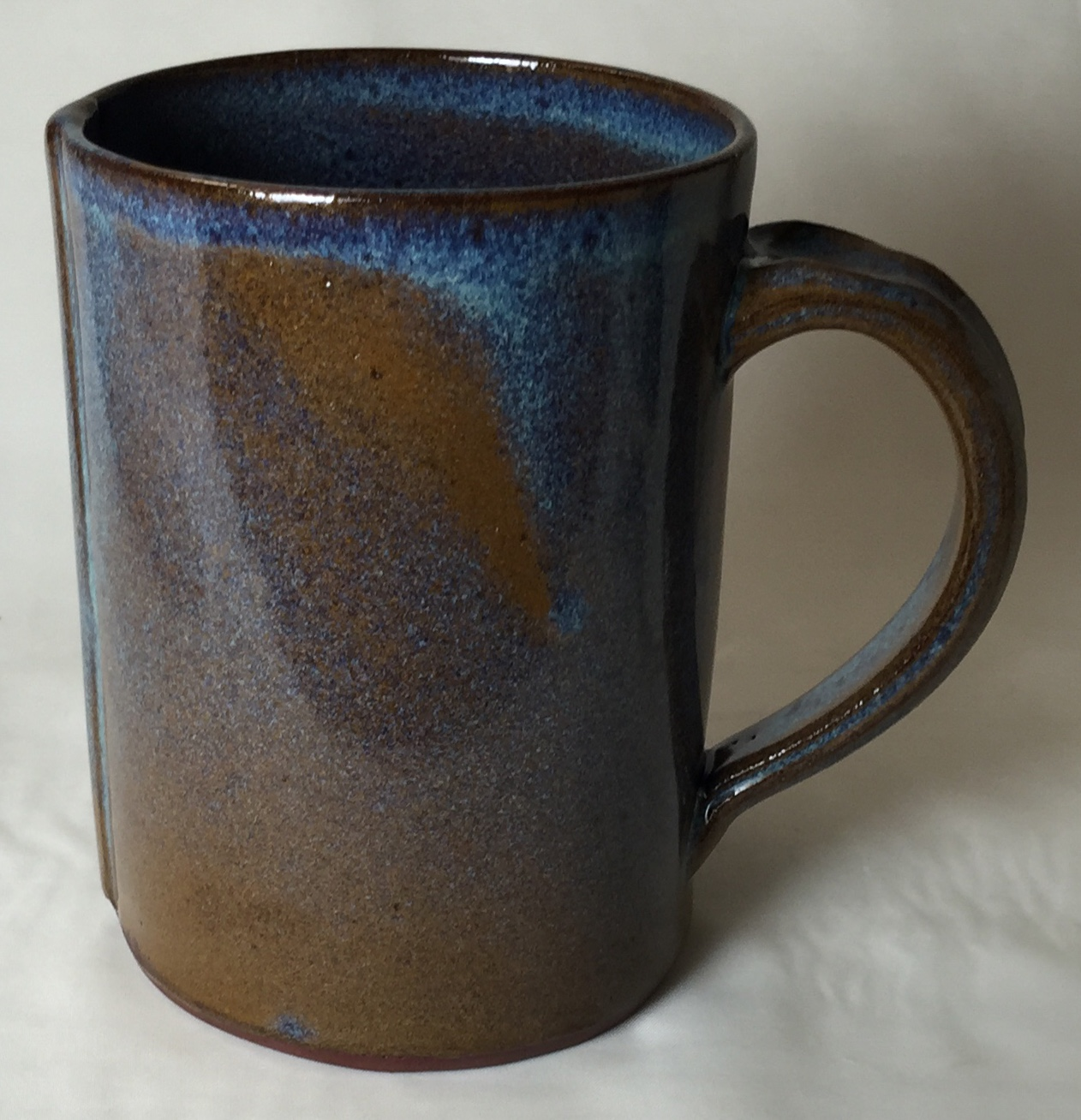 Alberta Slip Rutile blue glaze too thin on a dark body