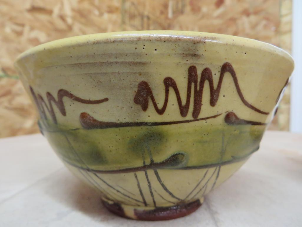 Pinholing with a boron fluxed cone 04 opacified and stained glaze