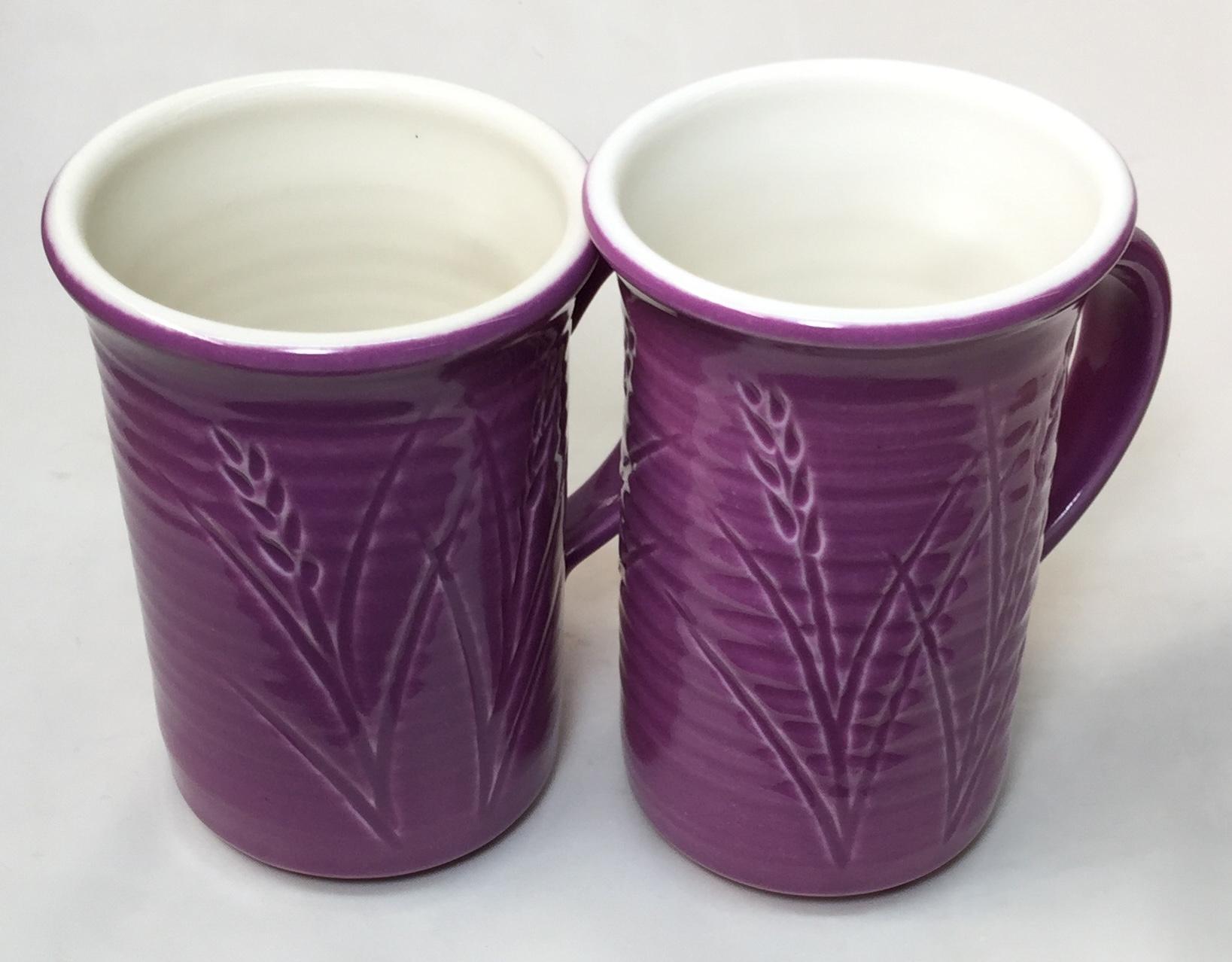 Two purple-outside, white inside thrown Grolleg cone 6 porcelain mugs