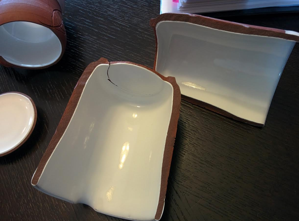 Why is this vitreous low fire ware cracking out of the kiln like this?