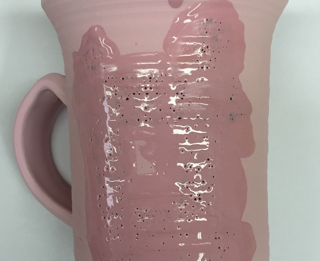 Underglaze decoration difficult to cover with clear overglaze