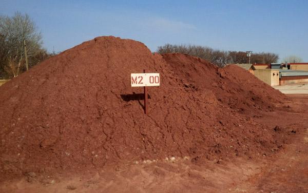 Raw red burning clay stockpile