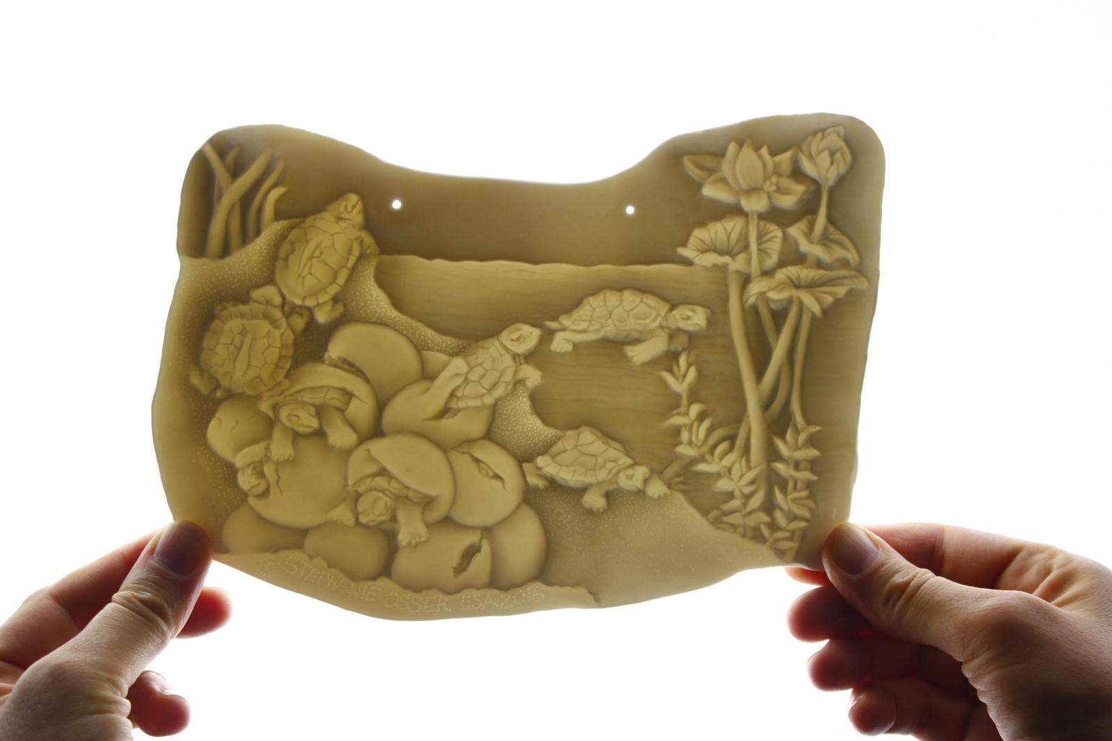 Lithophane by Stephanie Osser. Made using Herend Porcelain fired to cone 11+.