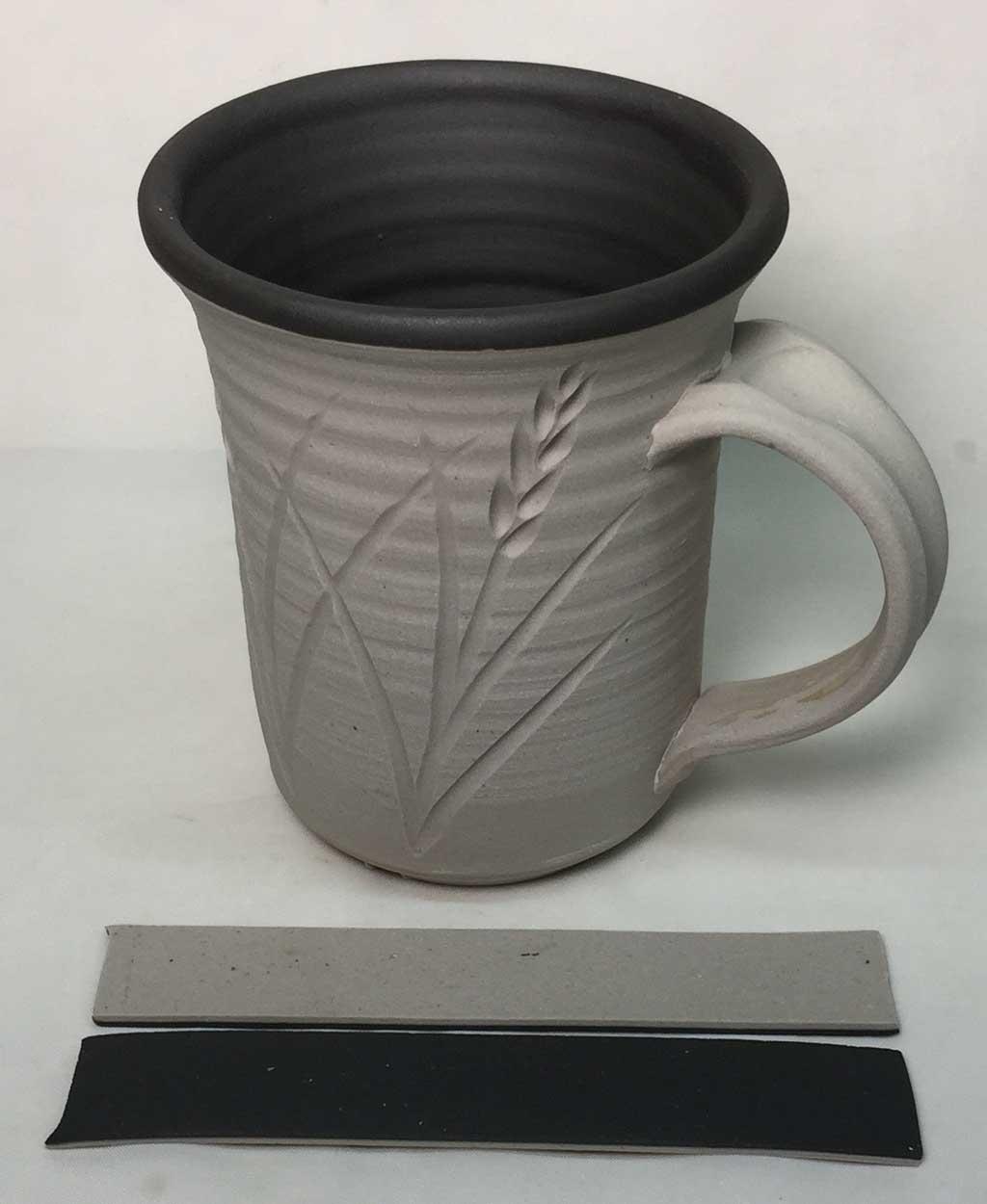 L3954J black engobe on a cone 10 whiteware body