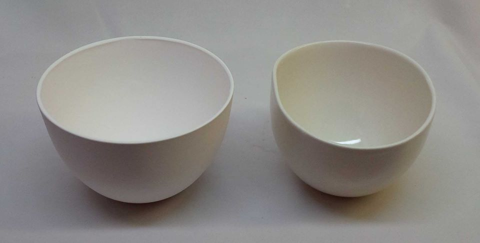 What are the two key causes of firing warpage in porcelain?