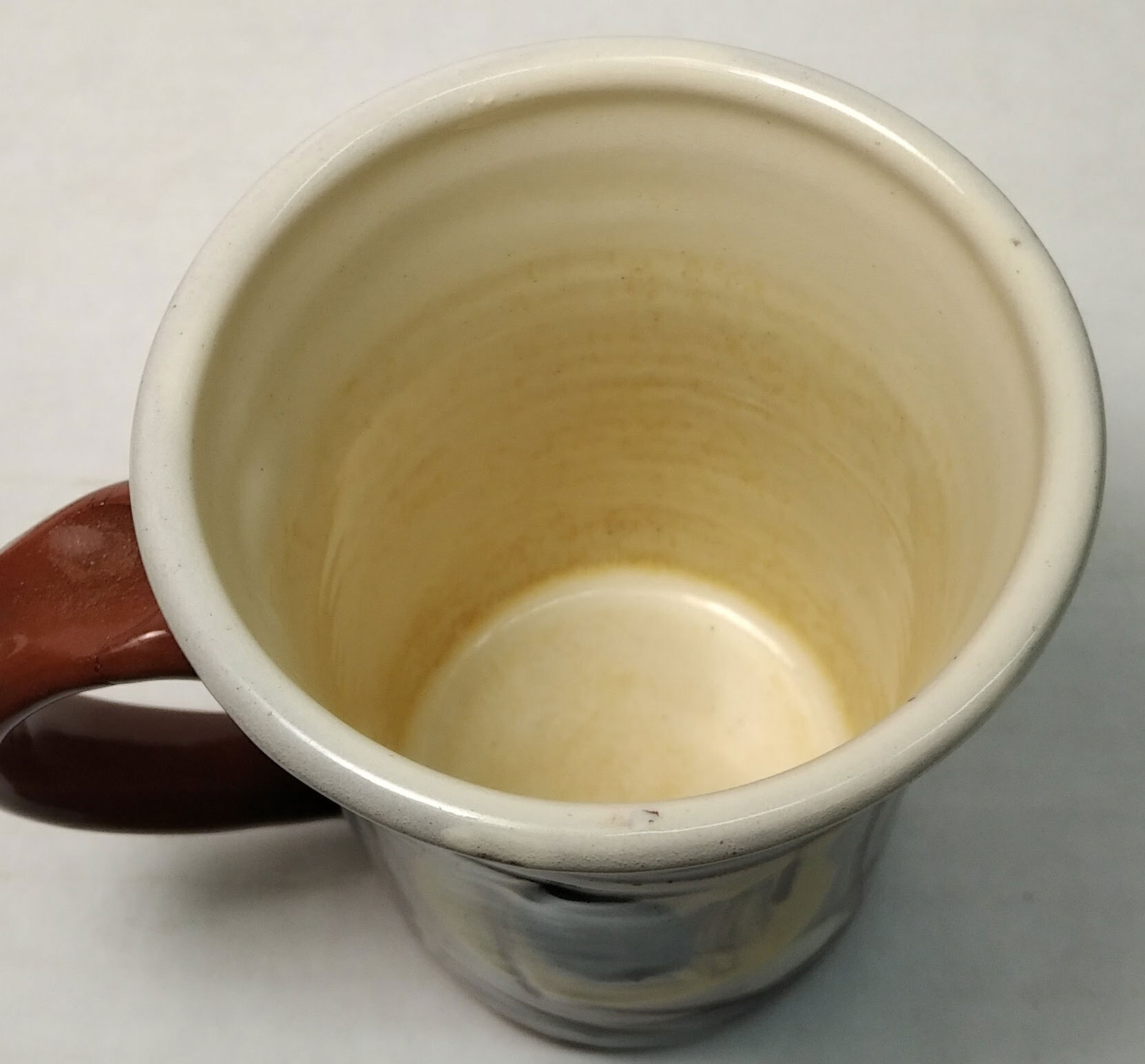 Glaze is coffee-staining and leaching after two years. Is it toxic?