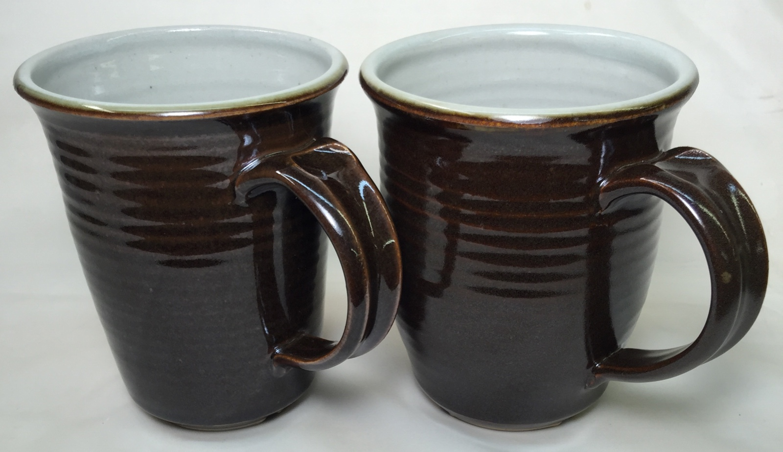 Cone 10R kiln variation shows in tenmoku glaze