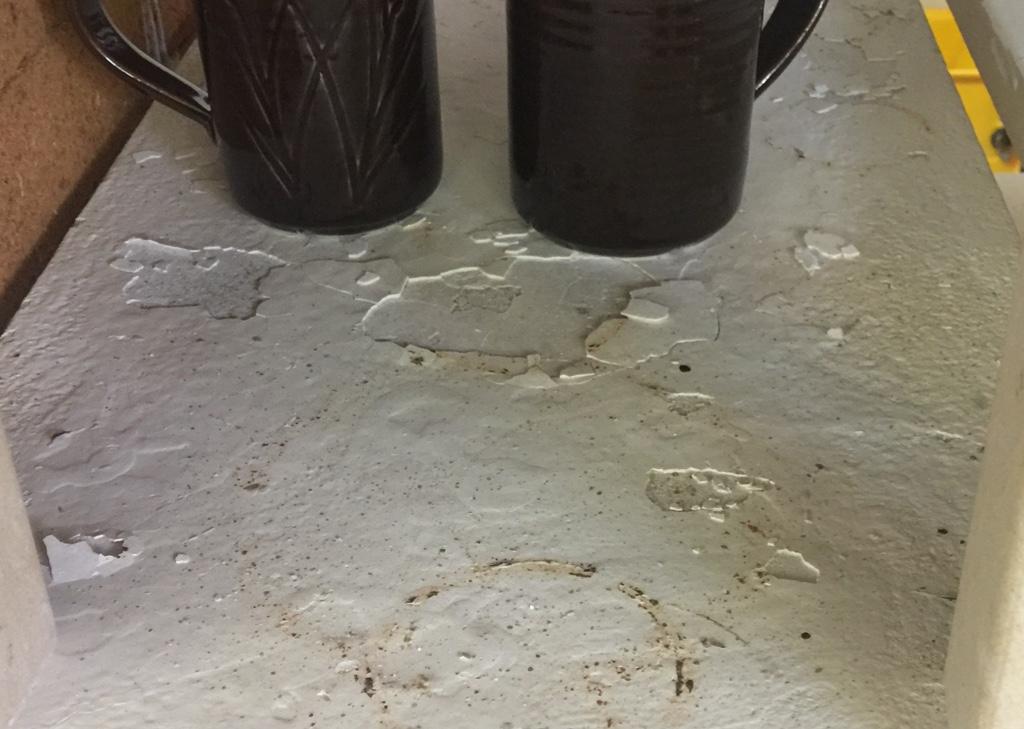 Flaking kiln wash on a silicon carbide kiln shelf