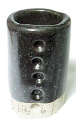 A metallic, silky crystal black glaze based on Alberta Slip